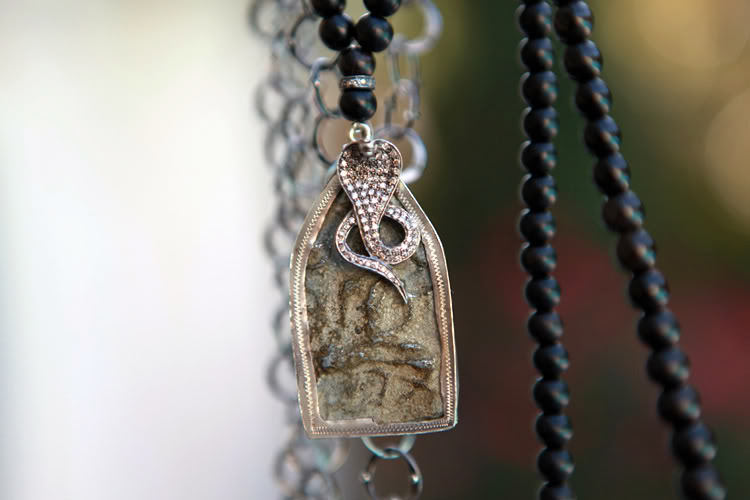 Buddha and Naga Amulet by The Woods from Life in Travel