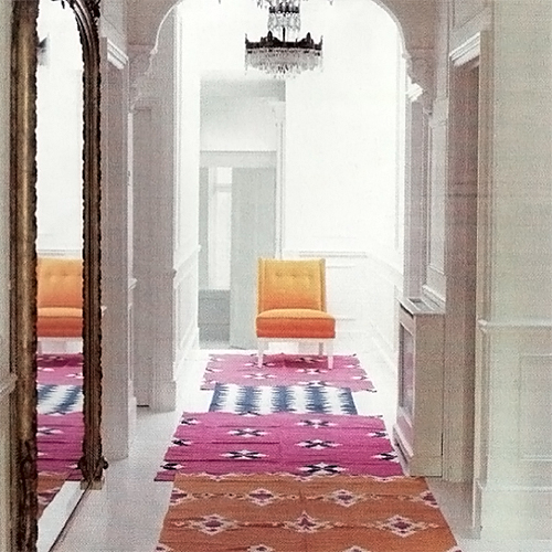 Layered Rugs in Hallway