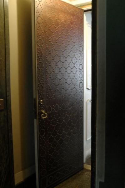 Nail Head Pattern on Leather Door