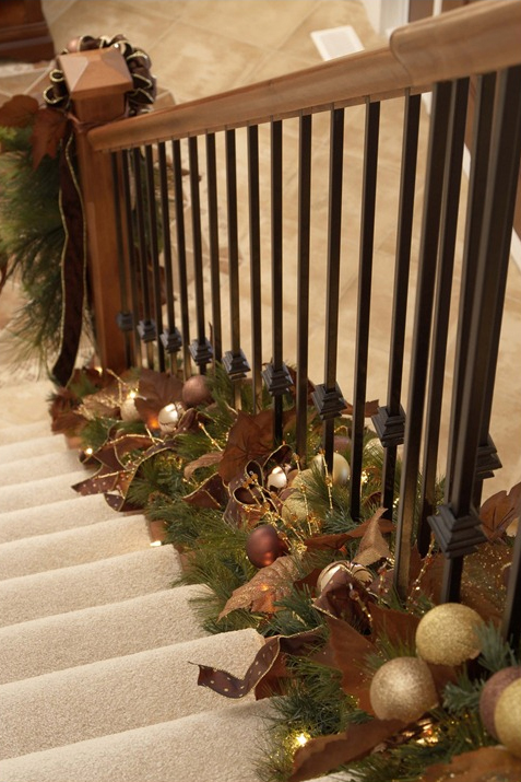 Holiday decor twist garland at the bottom of stair for Stair railing decorated for christmas