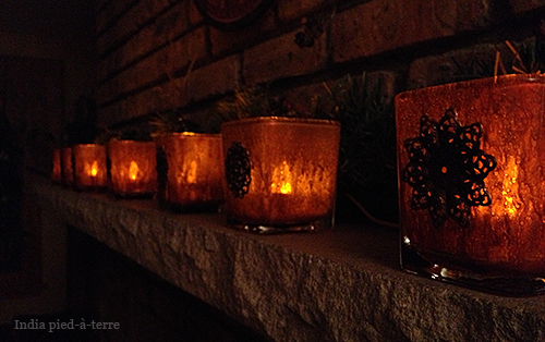 Row of Mercury Glass Votive Holders on Fireplace Mantel