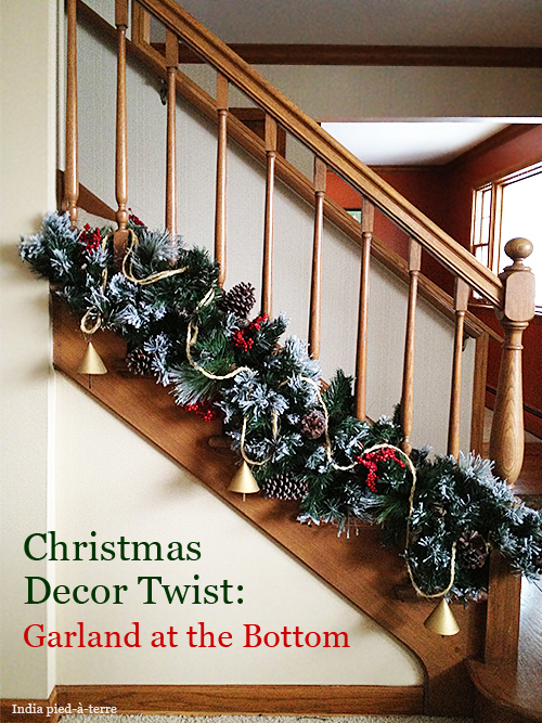 put your christmas garland on the bottom of the staircase railing