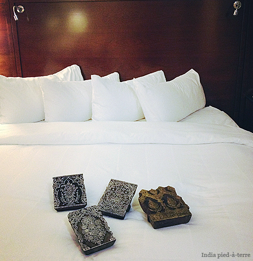 Wood Indian Printing Blocks and Crisp White Hotel Linens Uh-oh