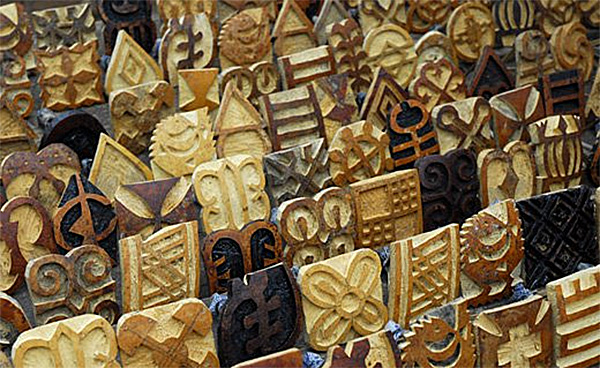 Adinkra Stamps Carved from Guords
